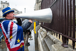 London, UK. 8 May, 2019. Steve Bray of SODEM (Stand of Defiance European Movement) protests with a loud hailer outside Parliament shortly before Prime Minister's Questions.
