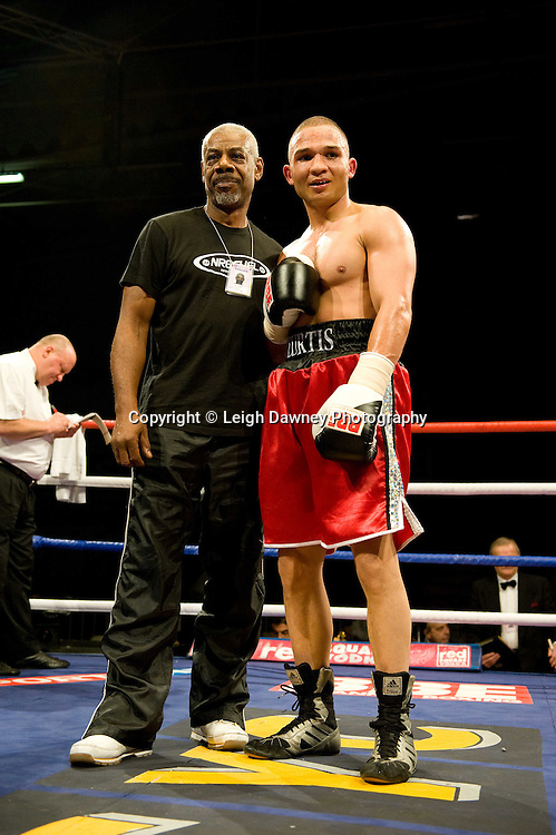 Curtis Valentine (red shorts) defeats Ryan Clark at the Harvey Hadden Leisure Centre 5th February 2010 Frank Maloney Promotions . Photo credit © Leigh Dawney