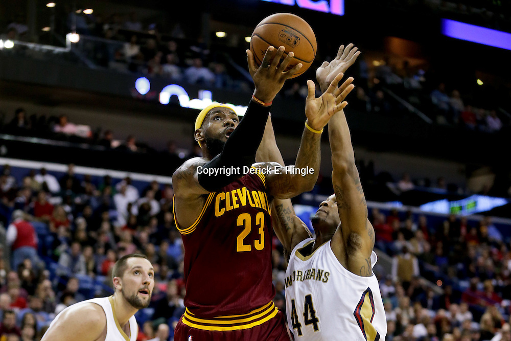 Dec 12, 2014; New Orleans, LA, USA; Cleveland Cavaliers forward LeBron James (23) shoots over New Orleans Pelicans forward Dante Cunningham (44) during the second half of a game at the Smoothie King Center. The Pelicans defeated the Cavaliers 119-114. Mandatory Credit: Derick E. Hingle-USA TODAY Sports