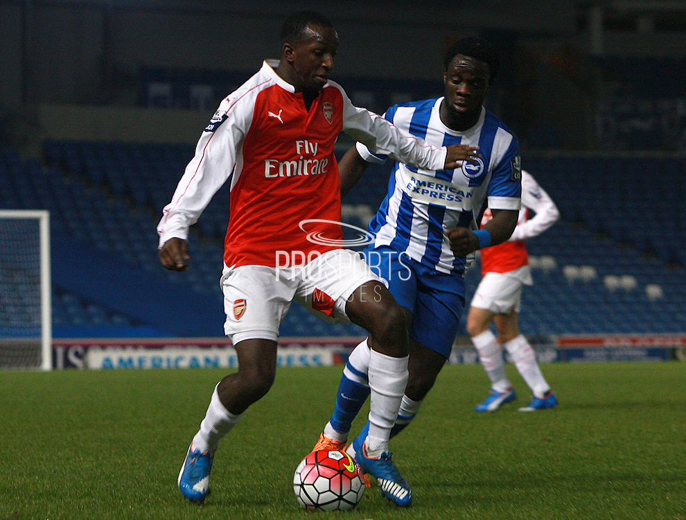 Arsenal defender Glen Kamara gets the better of Brighton striker Elvis Manu during the Barclays U21 Premier League match between Brighton U21 and Arsenal U21 at the American Express Community Stadium, Brighton and Hove, England on 30 November 2015. Photo by Bennett Dean.