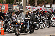 A biker wearing horns on his helmet cruises down Main Street during the 74th Annual Daytona Bike Week March 7, 2015 in Daytona Beach, Florida.
