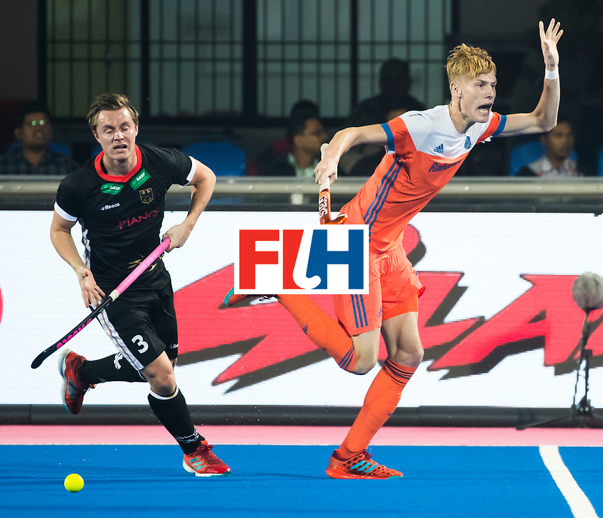 BHUBANESWAR - Joep de Mol (Ned) met Mats Grambusch (Ger)  tijdens de Hockey World League Finals , de kwartfinale wedstrijd Duitsland-Nederland (3-3).Duitsland wint na shoot-outs.    COPYRIGHT KOEN SUYK