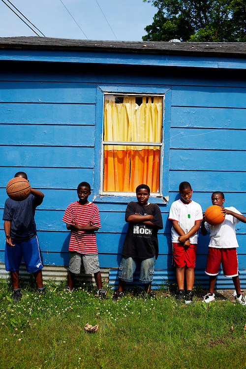 Tray Whitaker, 11, Jonathan Charles Edwards, 9, Dre Cork, 11, Rick Russell, 10, Jaelin Wilson, 11, stop playing to pose for a portrait in the Baptist Town neighborhood of Greenwood, Mississippi on Wednesday, May 19, 2010.