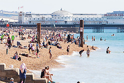 © Licensed to London News Pictures. 15/09/2019. Brighton, UK. Members of the public take advantage of one of the last days of sunshine to spend time on the beach in Brighton and Hove. Photo credit: Hugo Michiels/LNP