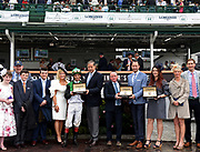 Charles Villoz, center left, Vice President of Longines, and Pascal Savoy, center right, Longines US Brand President, present Longines Conquest Classic Collection timepieces to trainer Brendan Walsh, center, jockey John Velazquez and connections of Proctor's Ledge after winning the Longines Churchill Distaff Turf Mile, Saturday, May 5, 2018 at Churchill Downs in Louisville, Ky.  Longines, the Swiss watch manufacturer known for its luxury timepieces, is the Official Watch and Timekeeper of the 144th annual Kentucky Derby. (Photo by Diane Bondareff/Invision for Longines/AP Images)