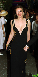 Actress and model Liz Hurley, arriving for the charity premiere of the film 'Four Weddings and a Funeral' at the Odeon in London's Leicester Square. Miss Hurley wears a revealing Versace evening dress.