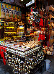 Typical shop selling Chinese souvenirs, West Street, Yangshou. Yangshuo is a county and city under the jurisdiction of Guilin City, in the northeast of Guangxi Province, China. Its seat is located in Yangshuo Town. Surrounded by karst peaks and bordered on one side by the Li River it is easily accessible by bus or by boat from nearby Guilin. It is a major tourist and resort destination for Chinese and foreigners alike.