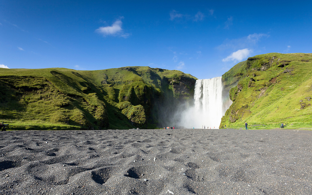 Tourists by Skogafoss, low view