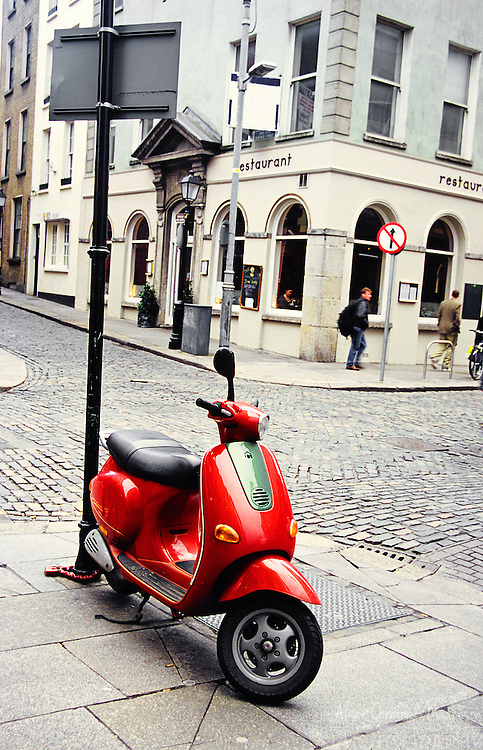 A scooter awaits its owner on a Dublin Street.