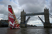 CAMPER with Emirates Team New Zealand sails up the Thames river to London for a media event at the London Design Museum. Passing under Tower bridge. 5/9/2011