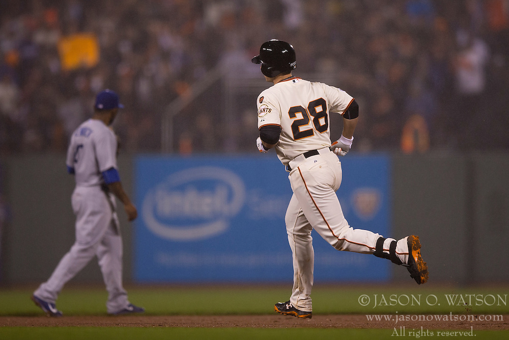 SAN FRANCISCO, CA - MAY 20:  Buster Posey #28 of the San Francisco Giants rounds the bases after hitting a home run against the Los Angeles Dodgers during the seventh inning at AT&T Park on May 20, 2015 in San Francisco, California.  The San Francisco Giants defeated the Los Angeles Dodgers 4-0. (Photo by Jason O. Watson/Getty Images) *** Local Caption *** Buster Posey
