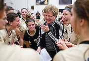 Grand Island Northwest Head Coach Diane Rouzee meets with her team after their victory over Columbus in the B-3 subdistrict match Saturday in Grand Island. Northwest defeated Columbus 25-13, 25-11, 25-10. The victory was Head Coach Diane Rouzee's 700th career win.