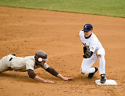 Virginia Cavaliers shortstop Greg Miclat (2) tries to pick off a Lehigh base runner.  The #17 ranked Virginia Cavaliers baseball team defeated the Lehigh Mountain Hawks 5-1 in the 2008 season opener at the University of Virginia's  Davenport Field in Charlottesville, VA on February 23, 2008.