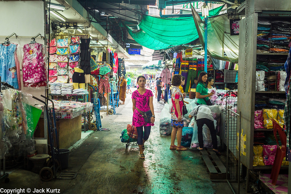 06 JUNE 2013 - BANGKOK, THAILAND:     A woman walks through Bobae Market in Bangkok. Bobae Market is a 30 year old market famous for fashion wholesale and is now very popular with exporters from around the world. Bobae Tower is next to the market and  advertises itself as having 1,300 stalls under one roof and claims to be the largest garment wholesale center in Thailand.       PHOTO BY JACK KURTZ