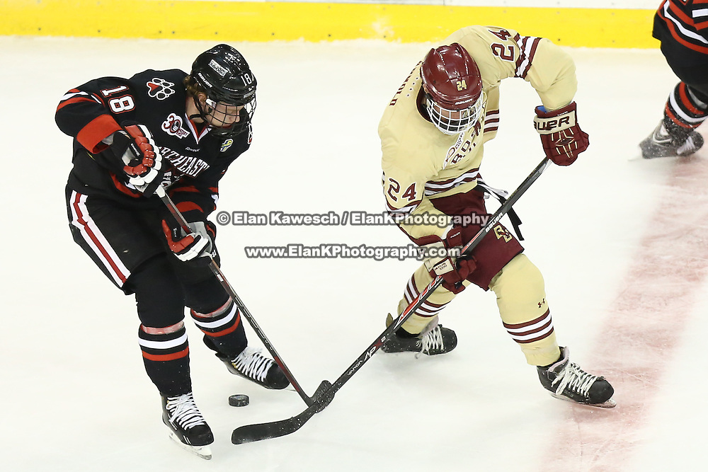 John Stevens #18 of the Northeastern Huskies and Bill Arnold #24 of the Boston College Eagles fight for the puck during The Beanpot Championship Game at TD Garden on February 10, 2014 in Boston, Massachusetts. (Photo by Elan Kawesch)