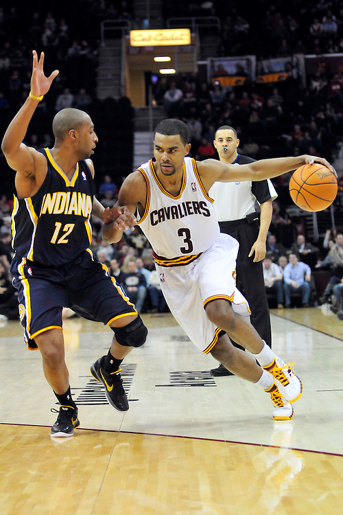 Feb. 2, 2011; Cleveland, OH, USA; Cleveland Cavaliers point guard Ramon Sessions (3) drives around Indiana Pacers guard A.J. Price (12) during the second quarter at Quicken Loans Arena. Mandatory Credit: Jason Miller-US PRESSWIRE