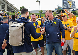 Sep 22, 2018; Morgantown, WV, USA; West Virginia Mountaineers quarterback Will Grier (7) hugs his father Chad Grier before entering the stadium to play Kansas State Wildcats at Mountaineer Field at Milan Puskar Stadium. Mandatory Credit: Ben Queen-USA TODAY Sports