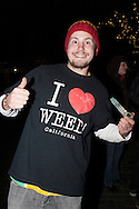 December 6, 2012. Seattle, Washington. Washington and Colorado became the first states to vote to decriminalize and regulate the possession of an ounce or less of marijuana by adults over 21. Pictured at a 'Stash Mob' gathering in Seattle is Eric Bertoglio, wearing an 'I heart Weed' t-shirt...Photo © John Chapple / www.JohnChapple.com
