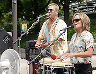 Jim Merrick (left,) Kim Merrick and the Grateful Parrott Band perform in the Fraze area of the Holiday at Home festival, Sunday, September 6, 2009.