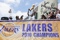 21 June 2010: Kobe Bryant of the Los Angeles Lakers holds up the Larry O'Brien Championship Trophy during the Lakers Championship Victory Parade on Figueroa BL. in Los Angeles, CA after the Lakers won the 2010 NBA Championship over the Boston Celtics in Game 7 of the NBA Finals.