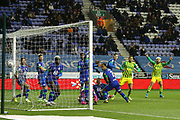 West Bromwich Albion forward Charlie Austin (15) scores from the free kick 1-1  during the EFL Sky Bet Championship match between Wigan Athletic and West Bromwich Albion at the DW Stadium, Wigan, England on 11 December 2019.