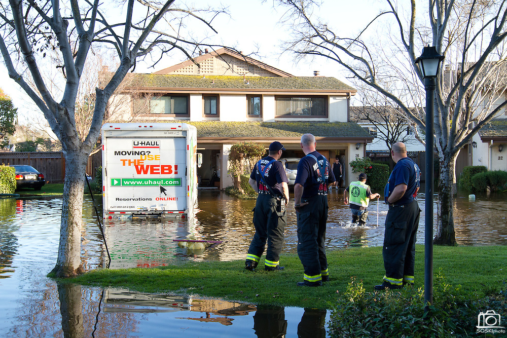 A U-Haul truck backed into a fire hydrant, flooding the neighborhood on Jacklin Place, Milpitas, Calif., around 4:30 pm on Saturday, Mar. 3, 2012.  Water levels reached the inside of several garages.  Photo by Stan Olszewski/SOSKIphoto.com