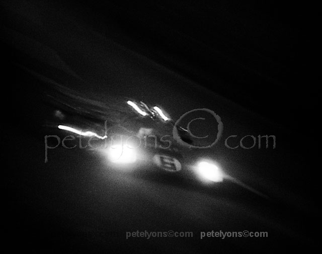 The Penske Racing Ferrari 512M of Donohue/Hobbs races through the night at Daytona 1971