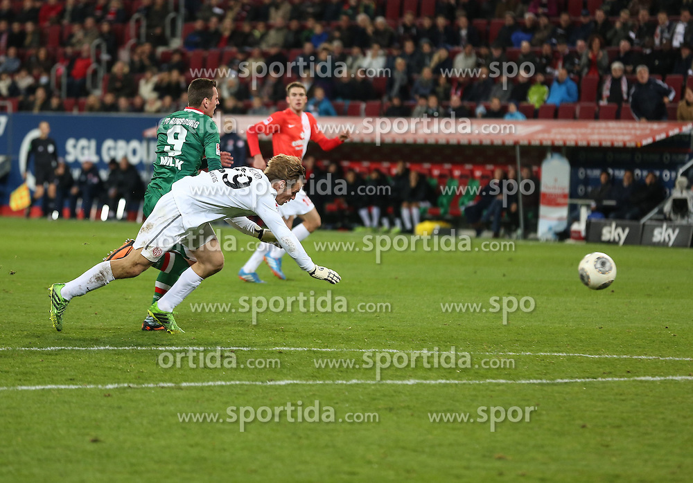 03.11.2013, SGL Arena, Augsburg, GER, 1. FBL, FC Augsburg vs 1. FSV Mainz 05, 11. Runde, im Bild Christian Wetklo (Torwart FSV Mainz 05) haelt Arkadiusz Milik (FC Augsburg) fest, verhindert ein Tor, Platzverweis, Rote Karte gegen Wetklo, // during the German Bundesliga 11th round match between FC Augsburg and 1. FSV Mainz 05 at the SGL Arena in Augsburg, Germany on 2013/11/03. EXPA Pictures &copy; 2013, PhotoCredit: EXPA/ Eibner-Pressefoto/ Krieger<br /> <br /> *****ATTENTION - OUT of GER*****
