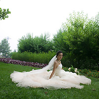 BEIJING, AUGUST 6 :  a bride sits in a park 2 days before the begining of the 2008 Olympics. he Olympics are seen as auspiscious to get married.