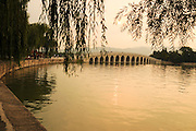 China, Beijing, Summer Palace built by Empress Cixi Seventeen Arched Bridge