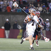 Matt Bocklet #7 of the Denver Outlaws looks to pass the ball during the game at Harvard Stadium on May 10, 2014 in Boston, Massachusetts. (Photo by Elan Kawesch)
