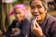 14 MARCH 2013 - BAN PANG SAI, LAOS: A woman smokes a traditional style pipe in the village of Ban Pang Sai in Luang Namtha province in northern Laos. PHOTO BY JACK KURTZ