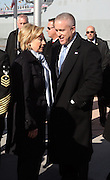 l to r: U.S. Secretary of State Hillary Clinton and Bill White, Executive Director, USS Intrepid at the officilal commissioning for The USS New York, whose bow is designed with 7.5 tons of steel from the World Trade Center. It is a San Antonio class amphibious transport dock ship, Ceremony was held at Pier 86 on Novemeber 7, 2009 in New York City