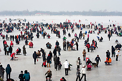 Many people having fun on frozen Songhua River during winter in Harbin China