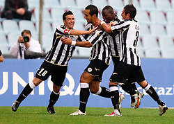 Denis German Gustavo and other players of Udinese celebrate during football match between Udinese Calcio and Palermo in 8th Round of Italian Seria A league, on October 24, 2010 at Stadium Friuli, Udine, Italy.  Udinese defeated Palermo 2 - 1. (Photo By Vid Ponikvar / Sportida.com)