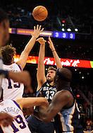 Nov. 5 2010; Phoenix, AZ, USA; Memphis Grizzlies center Marc Gasol (33) puts up a shot during the first half against Phoenix Suns center Robin Lopez (15) at the US Airways Center. Mandatory Credit: Jennifer Stewart-US PRESSWIRE.