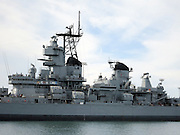 Photograph of the USS Iowa, a World War II battleship at its permanent berth as a museum and tourist attraction, taken on a Long Beach Harbor and Los Angeles Harbor boat cruise on March 2, 2013 in Long Beach, California. ©Paul Anthony Spinelli