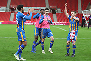 Shrewsbury Town players celebrate their win during the The FA Cup 3rd round replay match between Stoke City and Shrewsbury Town at the Bet365 Stadium, Stoke-on-Trent, England on 15 January 2019.