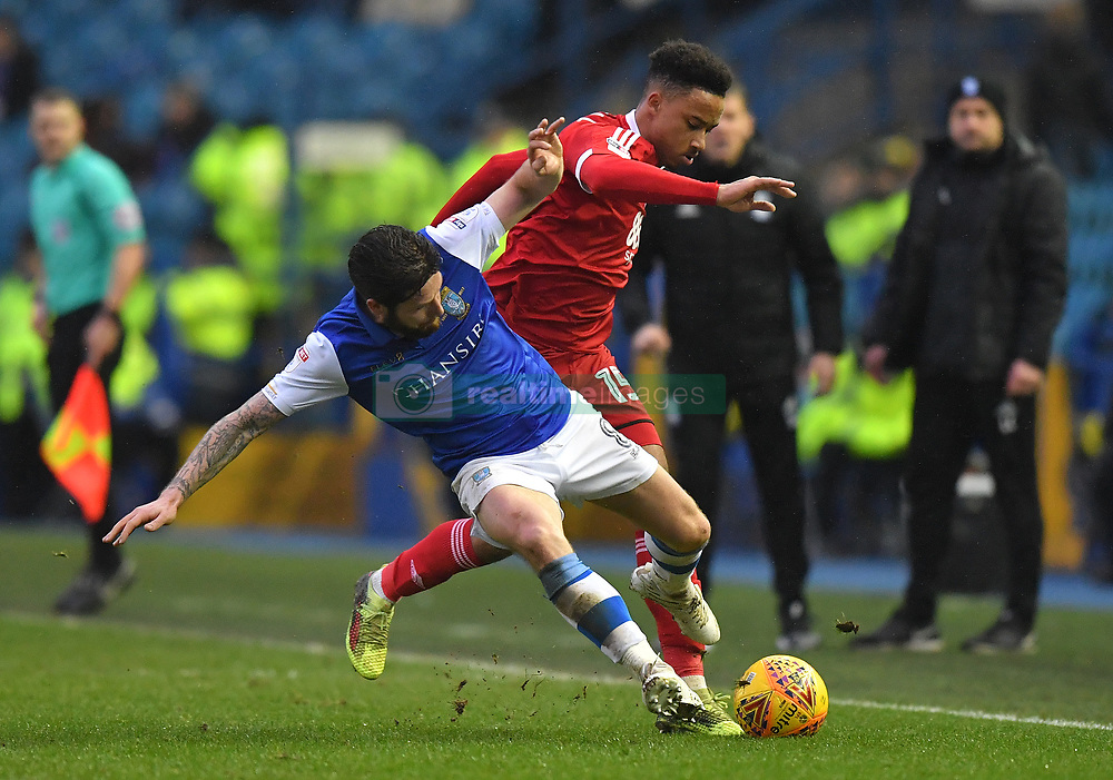 Birmingham City's Cohen Bramall battles with Sheffield Wednesday's Jacob Butterfield