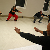 The Rev. Denvil Clark, right, leads Joe Lee Howard Jr., Verdie Clark, Jobi Ford and Charlie Metcalf in a stretching exercise at the High Street Community Center. Not pictured is Vera Willis.