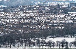 Edinburgh, Scotland, United Kingdom. 29 December, 2017; Snow falls on Edinburgh enhancing views of the city. The Meadows and rooftops of apartment buildings in Bruntsfield and Marchmont covered in snow.