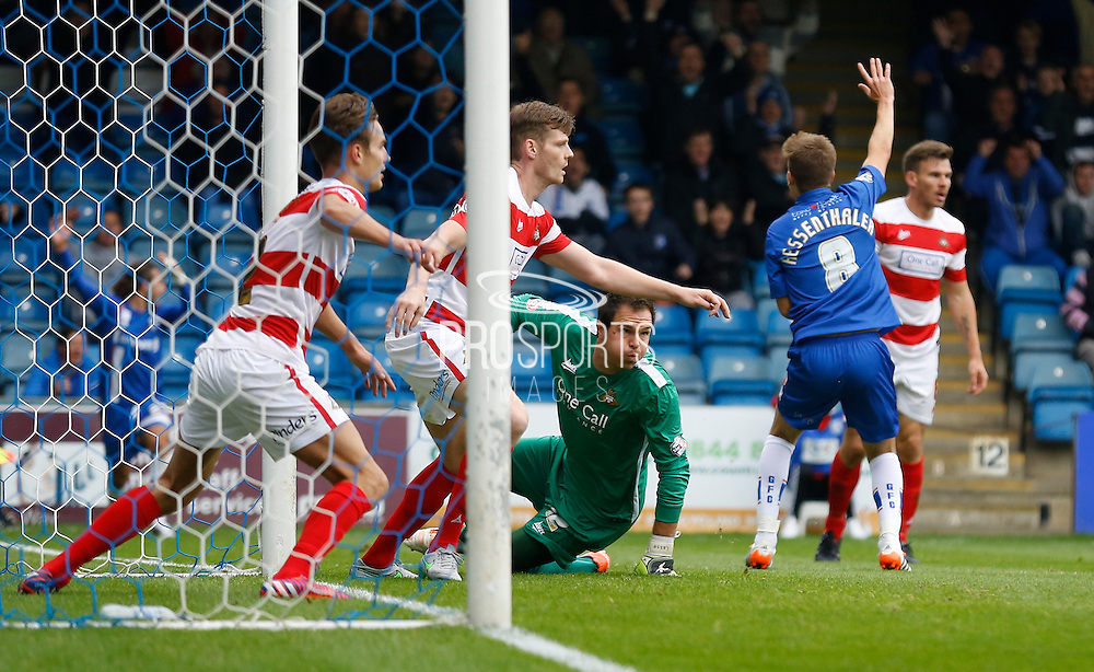 Play continues for moments until the linesman advises the ball did infact cross the line during the Sky Bet League 1 match between Gillingham and Doncaster Rovers at the MEMS Priestfield Stadium, Gillingham, England on 5 September 2015. Photo by Andy Walter.
