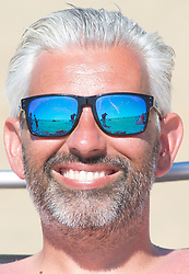 ©Licensed to London News Pictures 07/08/2020   Dymchurch, UK. Cool blue sunglasses. Dymchurch in Kent on the south coast. Scorching hot weather today in the UK as the heatwave weather looks set to continue into next week. Today could be one of the hottest on record if not the hottest. Photo credit: Grant Falvey/LNP
