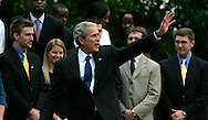 President George W. Bush wave at the conclusion of an event with thew NCAA Sports Champions on South Lawn on November 12, 2008.  Photograph by Dennis Brack