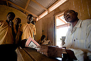 A teacher looks at students' work during class at the Ying Anglican Primary School in the Savelugu-Nanton district, northern Ghana on Monday June 4, 2007.