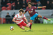 Doncaster Rovers Forward John Marquis (9) is fouled by Scunthorpe United midfielder Duane Holmes (19) during the The FA Cup match between Doncaster Rovers and Scunthorpe United at the Keepmoat Stadium, Doncaster, England on 3 December 2017. Photo by Craig Zadoroznyj.