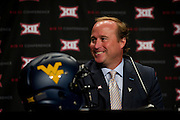 DALLAS, TX - JULY 22:  West Virginia head coach Dana Holgorsen speaks during the Big 12 Media Day on July 22, 2014 at the Omni Hotel in Dallas, Texas.  (Photo by Cooper Neill/Getty Images) *** Local Caption *** Dana Holgorsen