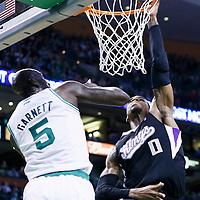 30 January 2013: Sacramento Kings power forward Thomas Robinson (0) goes for the dunk over Boston Celtics power forward Kevin Garnett (5) during the Boston Celtics 99-81 victory over the Sacramento Kings at the TD Garden, Boston, Massachusetts, USA.