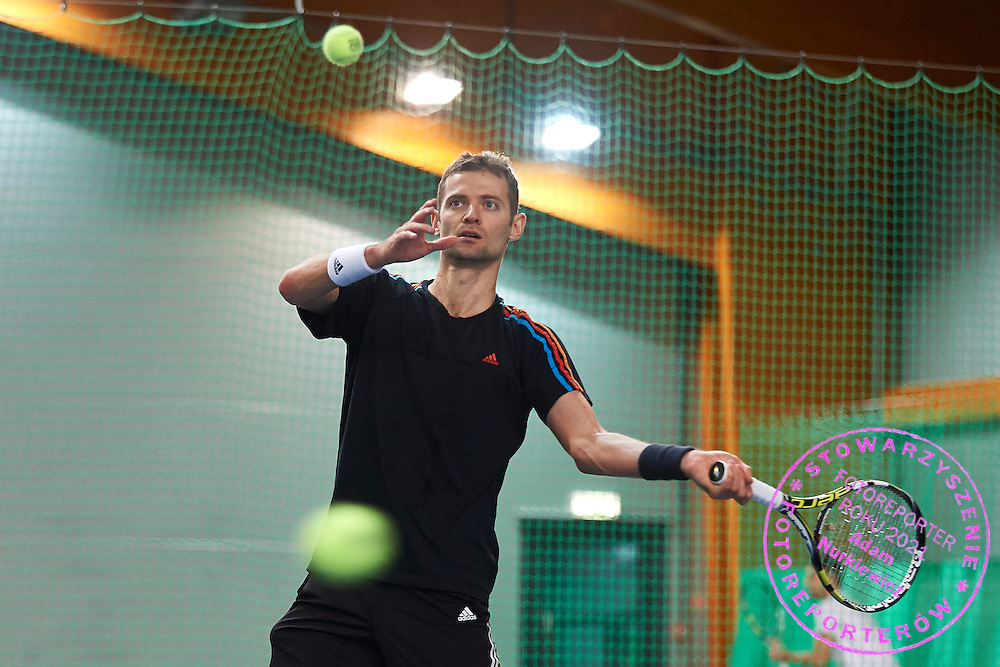 Mariusz Fyrstenberg pladuring training session while Polish Tennis Association Davis Cup Team Training Camp at Deski Tennis Club in Warsaw, Poland.<br /> <br /> Poland, Warsaw, December 18, 2014<br /> <br /> Picture also available in RAW (NEF) or TIFF format on special request.<br /> <br /> For editorial use only. Any commercial or promotional use requires permission.<br /> <br /> Mandatory credit:<br /> Photo by &copy; Adam Nurkiewicz / Mediasport
