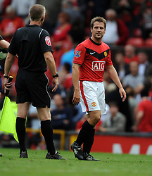 Michael Owen of Manchester United chats with the linesman during the Barclays Premier League match between Manchester United and Birmingham City at Old Trafford on August 16, 2009 in Manchester, England.